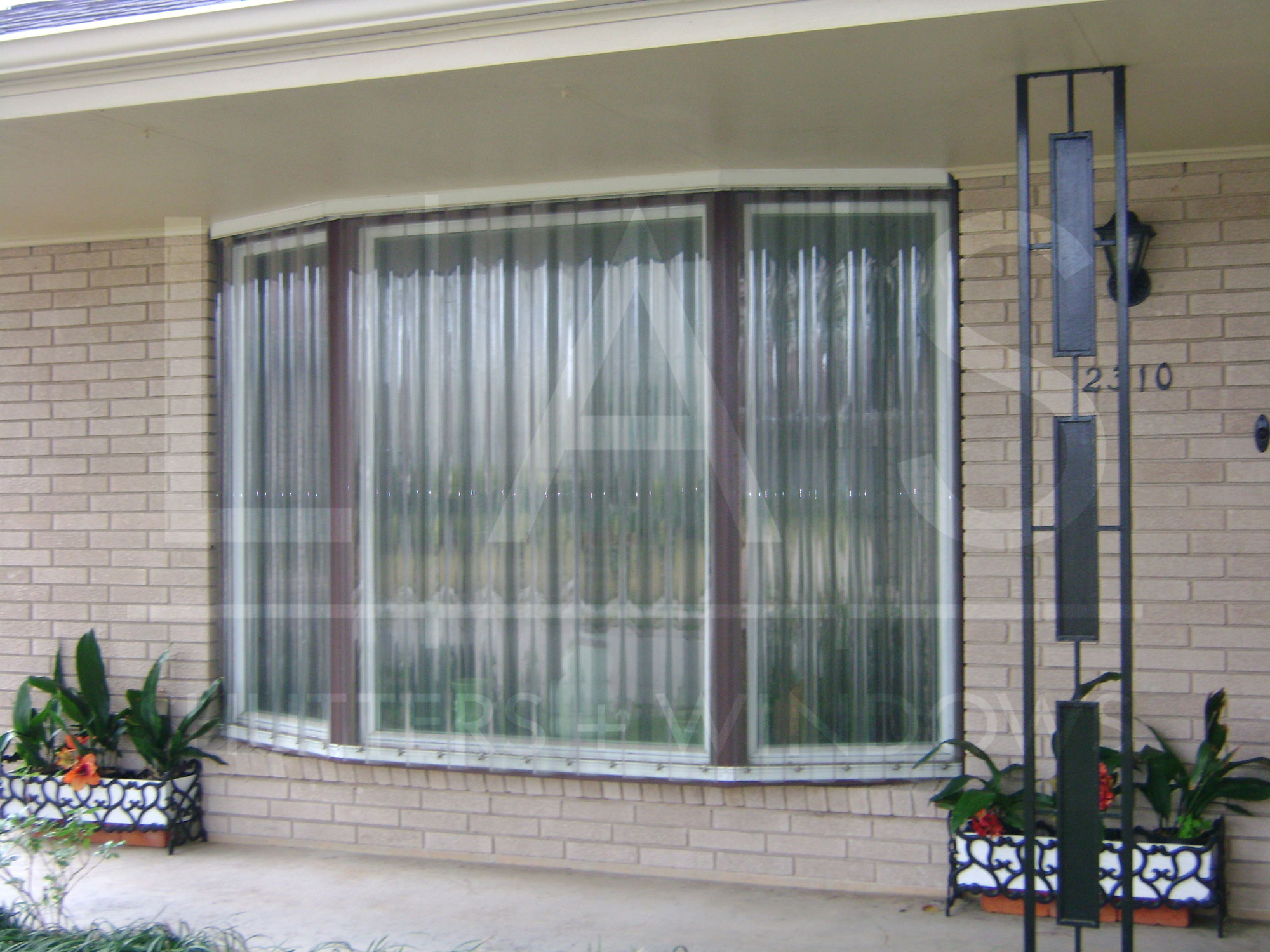 What are the best hurricane shutters for homes in new orleans - Types shutters consider windows ...