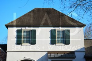 ' ' from the web at 'https://lashome.com/wp-content/uploads/LAS-Enterprises_Grand-Lakes_Board-and-Batten-Shutters_French-Quarter-Green_Double-Hung-Windows_External-Grids_Beige_1_web-300x200.jpg'