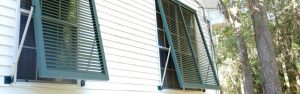 LAS Enterprises Green Bahama Shutters on White Siding